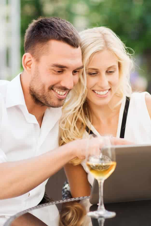 A couple purchasing wine online from Wilhelm Family Vineyards